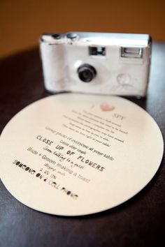 """I Spy"" wedding cards. But if you're looking for an alternative to disposable cameras, check out http://ourphotoopp.com  It's an App that allows instant guest photo sharing"