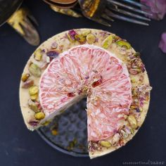 A festive raw vegan ice cream cake with beautiful accents of grapefruit and pistachios. This recipe is free from: dairy, refined sugar, gluten & grains.