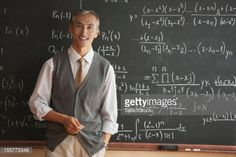 Stock Photo : Portrait of teacher with in front of blackboard