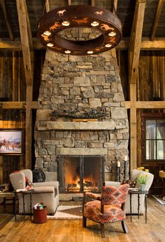 Natural stone fireplace under a vaulted ceiling. Keep furnishings simple to let the fireplace take center stage.