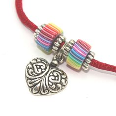 Heart necklace with polymer clay stripes rainbow beads and silver plated charms, valentine gift, pendant gift for girls and teens. $10.00, via Etsy.