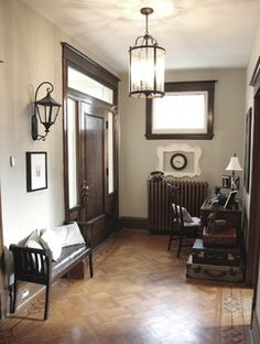 dark stained trim; medium parquet wood floors; radiator