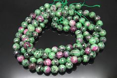 1strand  natural ruby in zoisite faceted ball sized 14mm by 3yes