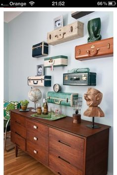 DIY suitcase shelving sure, but the cabinet is loverly.