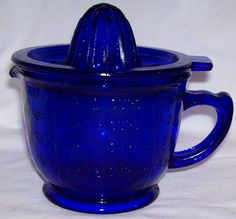 Cobalt blue Reamer and Measuring cup by RockingChairAntiques, etsy