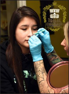 Good shot of our head piercer Nia in action getting ready to do one of the most popular piercings we offer, a classic nostril; Gold Body Jewellery, Body Jewelry, Tribal Expression, Body Piercing, Piercings, Piercing Studio, Tattoo Removal, Over The Years, Action