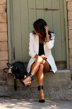 Black statement heels and a white blazer