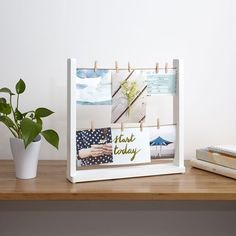 Great for displaying photos at work - clothesline desktop photo frame