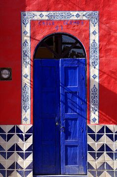 ~ bright blue door with red accent and chevron tile ~