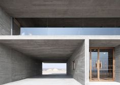 Cast-concrete library situated on a stretch of deserted beach facing the East China Sea.