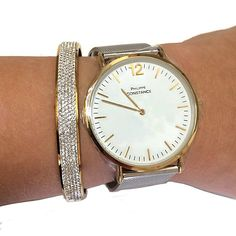 Mooie armbanden set met horloge in sjiek goud en  zilver met 1 slavenarmband goud  met Crystals van  rhinestone in RVS goud. Horloge is van RVS, merk Philippe Constance.