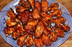 Spicy Oven Baked Barbecued Chicken Wings - A tasty oven barbecue chicken wing, seasoned generously with both Cavender's Greek seasoning and Cajun seasoning, then finished with your favorite barbecue sauce.