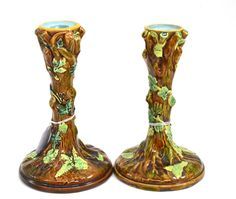 Tennants Auctioneers: A pair of George Jones majolica candlesticks modelled as tree trunks (one with crescent mark