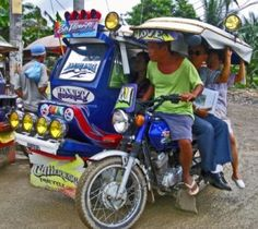 """Tricycle. """"Poor man cab"""" this is what usually people call this three wheeled vehicle that is concurring the roads (not in major roads) of different places in the Philippines today.  Trike as what others address them, have different colors that represent what route are they belong to. This vehicle can take up to 5 persons including the driver."""