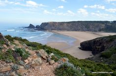 Odeceixe has one of the best beaches in Portugal with marked Rota Vicentina walking trails across dragon-shaped cliffs and wildflower-strewn countryside.