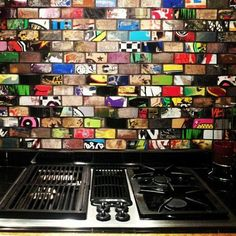 Design Envy : Upcycling old skateboards. Used decks are treated and made into tiles for counters, kitchen walls, etc.