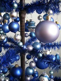 dark blue tree - totally reminds me of our first (and ONLY) flocked Christmas tree. My dad's cat pulled the ornaments off, shredded the satin thread decorating the balls, and tipped the whole tree over. Lol!