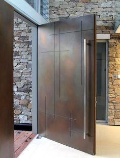 Katnich Building & Design                       Metal Front Door....great entrance piece.