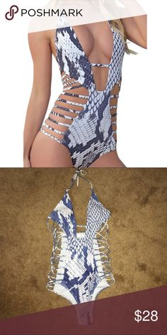 Strappy Monokini  Snakeskin design. Super cute pattern. NEW WITH LINER! Strappy details on the side, plunge V-neck halter. SAYS M BUT IT FITS LIKE S! It was tight on me and I am a 26/27. I recommend 25w, B cup bust for best fit. **NOT ACACIA, just for views** Instagram @ kat.btq !!NO TRADES!! acacia swimwear Swim One Pieces