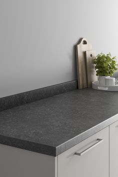 Our Howdens Onyx Blackstone Effect Laminate Worktop is a great place to start if you're looking for stone effect kitchen countertop ideas or laminate kitchen worktop ideas. They look amazing next to light grey kitchen cabinets and light grey walls to create a modern kitchen design. Finish with chrome kitchen hardware. Howdens Worktops, Kitchen Worktops, Grey Kitchen Cabinets, Kitchen Hardware, Worktop Ideas, Light Grey Kitchens, Light Grey Walls, Work Surface, Work Tops