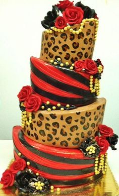 Black and red Topsy turvy complimented with hand painted cheetah print and embellished with touches of gold.    -- HottCakez of Las Vegas... Deliciously Sexy~~ Facebook.com/hottestcakezlv,