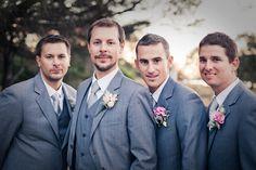 Handsome groomsmen wore grey.
