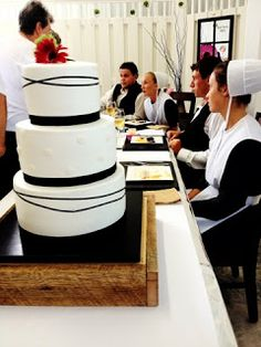 Amish Wedding..I'm thinking that this ultra-modern cake style would not be at an Amish wedding. I know they bake their own and everything is simple and humble. This may be a fake Amish picture. I have seen others before.