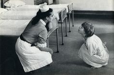 Staff Nurse Coaxing a Mental Patient, c. 1960's