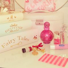 Girly necessities <3 I have that Britney Spears perfume (pink bottle-smells amazing-it's called fantasy (also try radiance)!