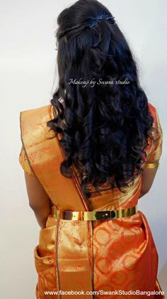 Indian bride's reception hairstyle by Swank Studio. Bridal hair. Curls. Saree Blouse Design. Hair Accessories. Tamil bride. Telugu bride. Kannada bride. Hindu bride. Malayalee bride. Find us at https://www.facebook.com/SwankStudioBangalore