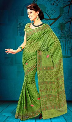Green Embroidered Cotton Printed Saree Look awesome dressed in this green shade cotton saree. Saree is beautified with decorative patterns and embroidered motifs that gives you a perfect look. Comes with a matching stitched round neck blouse with 6 inches sleeves. #SareesOnlineShopping #TraditionalFancyCottonSarees