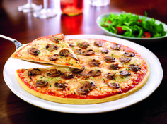Funghi - This popular vegetarian pizza is topped with the finest aromatic mushrooms, fruity tomatoes, and juicy Mozzarella cheese.