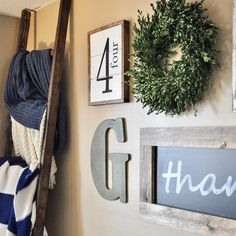 I love this gallery wall. The blanket ladder, boxwood wreath, and chalkboard are my favorite. Perfectly farmhouse rustic.