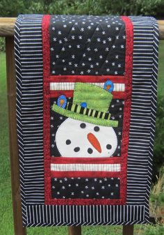 Snowman with White Snowflakes on Black Table by QuiltingGranny