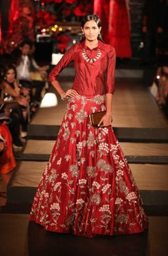 A red wedding lehenga by Manish Malhotra on thedelhibride.com  Outfit details: Red Lehenga with Embroidered Dust Gold Floral Motifs and Silk Cranberry Red Shirt - Manish Malhotra - Amazon India Couture Week 2015