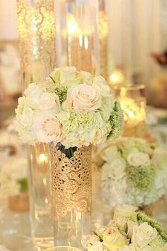 Glue gold doilies on the flower centerpiece vases... or on some of the candle vases