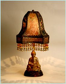 1920s Buddha Incense lamp with original gold finish is graced with a printed lame shade with metallic loop trim and colorful embroidered net. Beads are in matching tones and this lamp lights up beautifully.