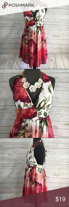 Twenty one Maryland Monroe floral Dress Sz Large Twenty one Size Large Halter Dress with empire waist. Marilyn Monroe inspired. Halter top ties in the back. Elastic around the back of the dress for a comfortable fit. Length 30.5 inches bust 16.5 inches waist 29 inches. Material  tag missing Twenty One Dresses