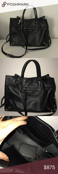 """Balenciaga Papier A4 Mini Black Leather Tote Bag Preowned Balenciaga Papier A4 Mini Black Leather Tote Bag in Black. Minor wear in very good condition. Originally purchased from Barney's in 2016. Soft calfskin mini tote bag with shiny silvertone hardware. Has thin, buckled tote handles @ 3.5"""" drop. Adjustable, removable shoulder strap @ 22"""" drop. Hidden magnetic closure w/side zip detail.  Exterior zip pocket. Removable hanging leather-frame hand mirror. Has interior slip pocket & Balenciaga…"""