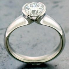 A William Travis Jewelry original. The simple tulip really highlights the stone. See more at williamtravisjewelry.com