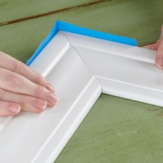 Lowes bathroom mirror frame Use tape to hold the frame corners together.
