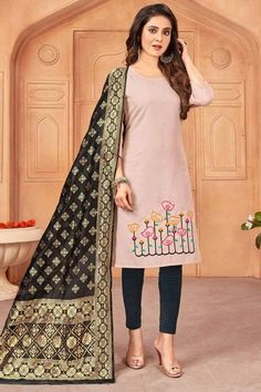 Let the next ethnic occasion see you flaunt a mesmerizingly vibrant avatar wearing this lavender pink cotton trouser suit which will add oodles of charm to your special ethnic look. This u neck and 3/4th sleeve outfit accentuated with thread work. Presented with cotton leggings in dusty black color and black banarasi silk dupatta. Leggings are plain. #trousersuit #salwarkameez #malaysia #Indianwear #Indiandresses #andaazfashion