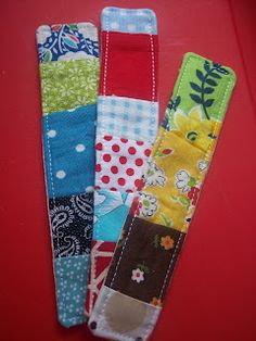 Scrappy bookmarks ... what a great way to use up fabric scraps, and easy to make in bulk.
