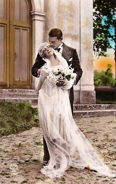 vintage bride and groom - reminds me of grandmother in laws dress... Married in 1921.. Veil like jellyfish.