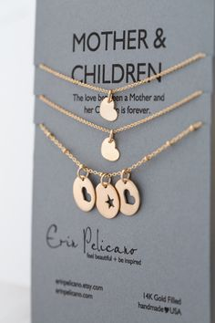 Mother & Children Necklace. Mother of the Bride Gift, Mother of the Groom Gift.  New Baby push present.  Mom birthday gift. This set of mother necklace and coordinating pieces represents the lifelong bond and love between mothers and children. Customize the number of daughters and sons in your set. The mother's necklace has one gold heart pendant and one gold star pendant for each child, on an 18″ gold beaded chain.