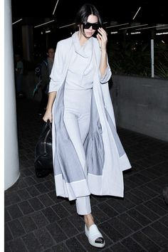 In a gray head-to-toe Toni Maticevski outfit, Celine sunglasses and Miu Miu shoes. - HarpersBAZAAR.com