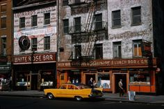 New York in 1960s. Love the whole building as a billboard above White Rose Bar.