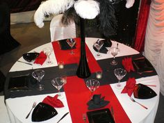 Red Satin Napkins accent the Black Table Linens and Black Chair ...
