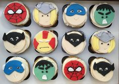 Custom superhero cupcakes with superhero fondant toppers. Characters include SpiderMan, Batman, and the Incredible Hulk.