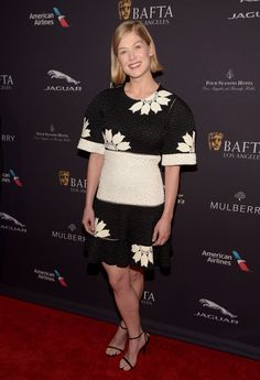 Pin for Later: From Bond Girl to Gone Girl: How Rosamund Pike Won the Award Season Red Carpet BAFTA Los Angeles Tea Party Keeping with her on-going red carpet trend of donning black and white, Rosamund made time for tea in an Alexander McQueen floral knit dress.